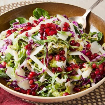 shaved brussels sprouts, cheese, purple cabbage and pomegranate salad