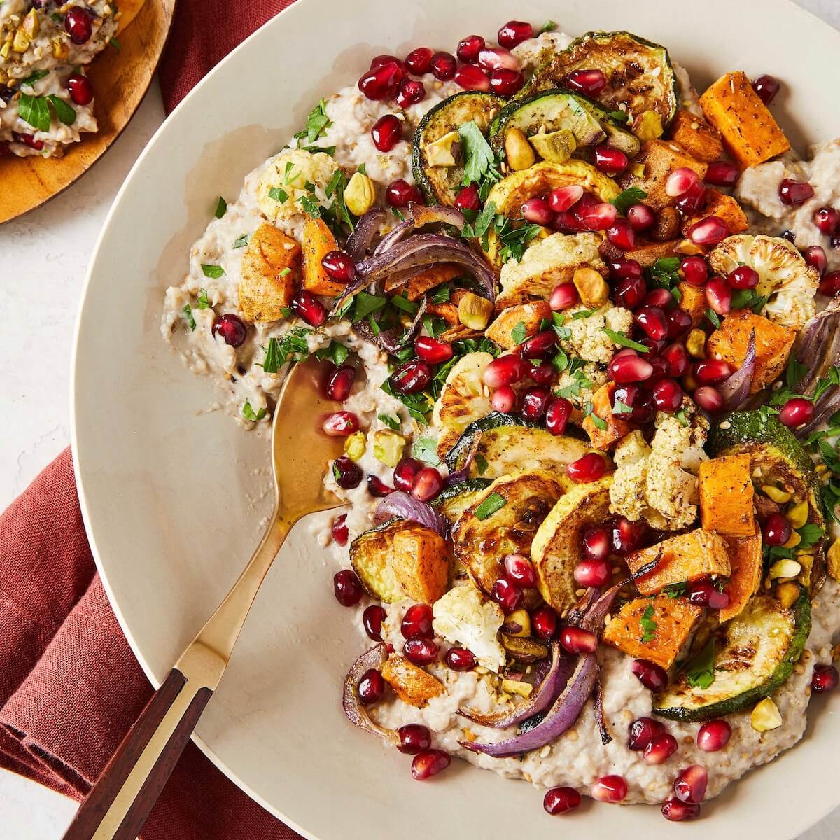 roasted eggplant dip with vegetables and pomegranates