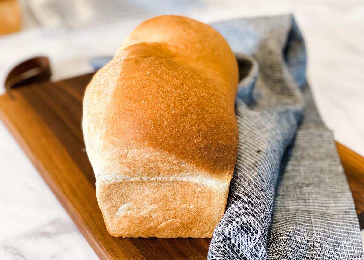 fluffy white bread recipe on cutting board