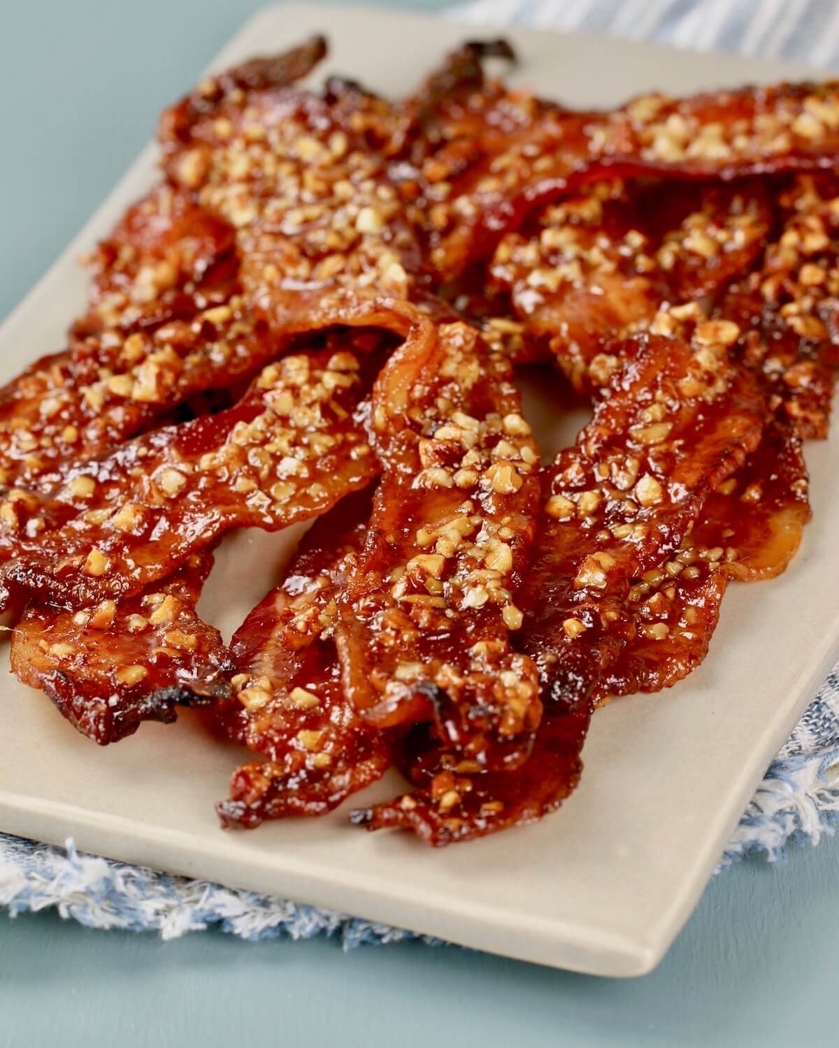 maple glazed bacon with spicy sweet caramel on a platter