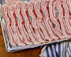 raw bacon ready for maple sauce