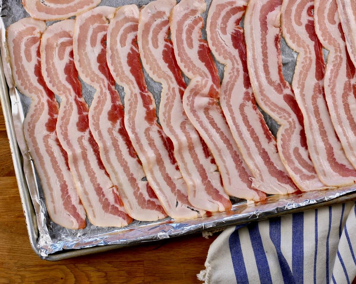 overhead view of raw bacon ready for maple sauce