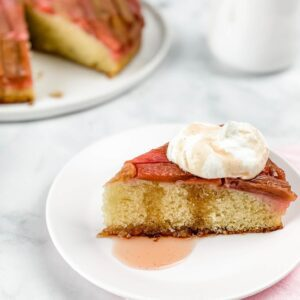 slice of rhubarb cake with sauce drizzle