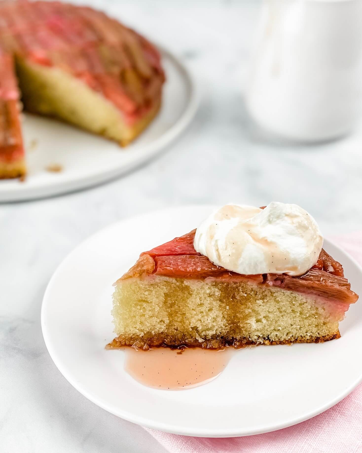 cake slice with rhubarb and whipped cream
