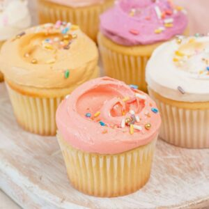 close up on pastel frosted cupcakes with sprinkles