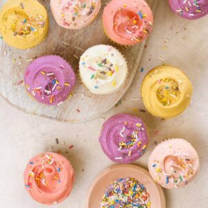 pastel colored frosted cupcakes with sprinkles