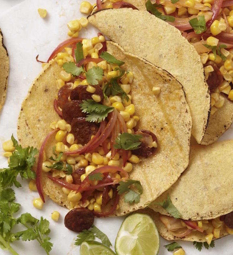corn tortillas filled with corn, onions and chorizo