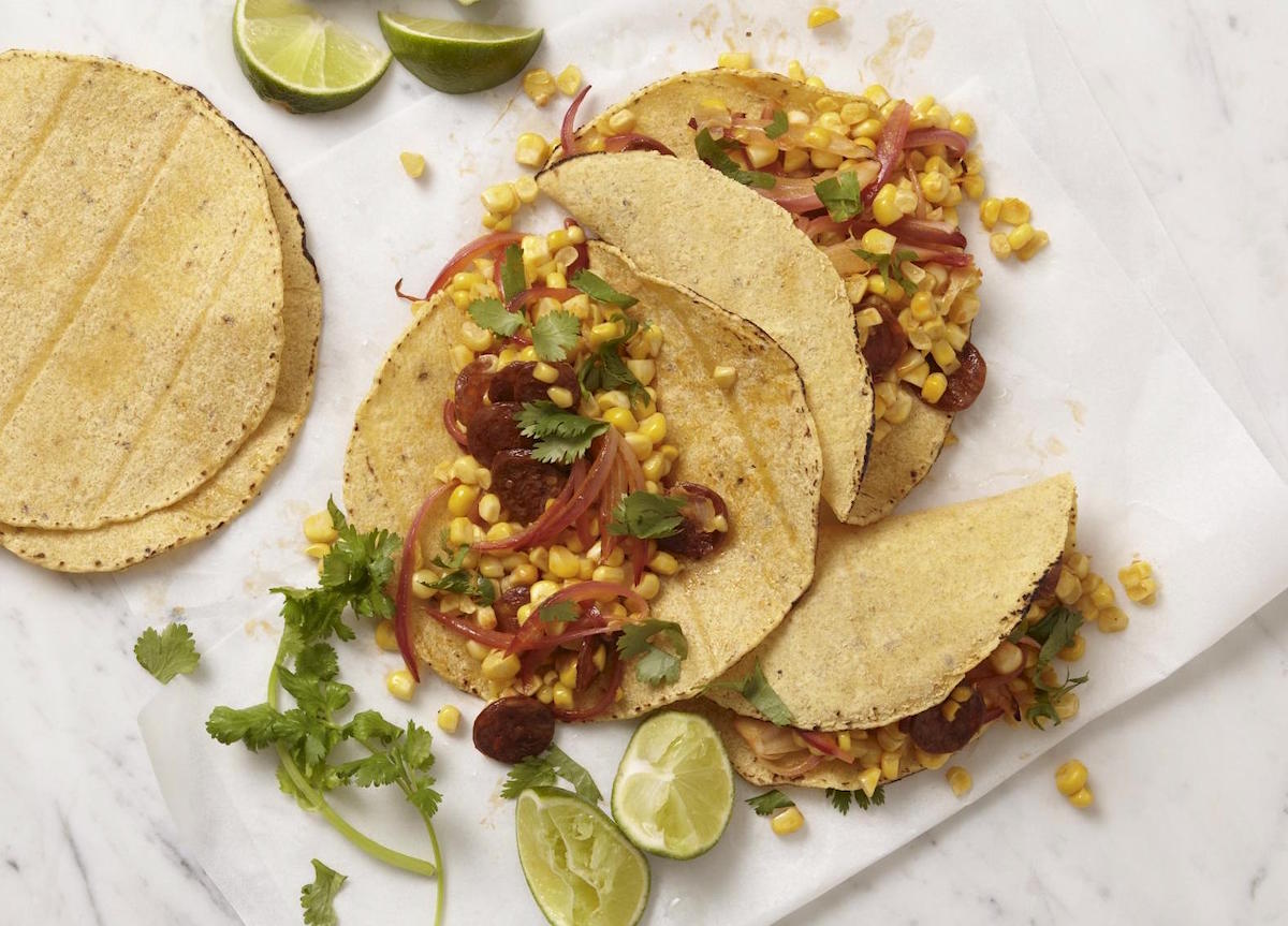 corn and chorizo tacos with lime wedges to squeeze