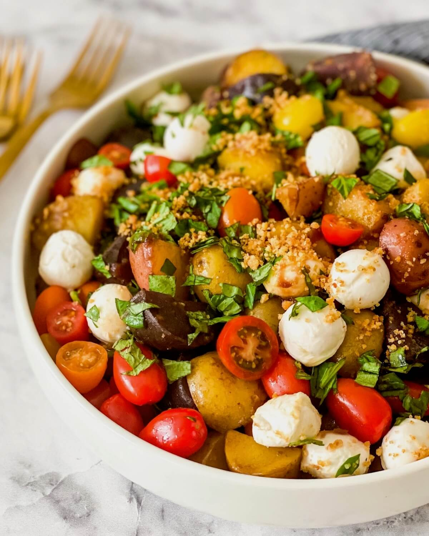 caprese ingredients in a potato salad