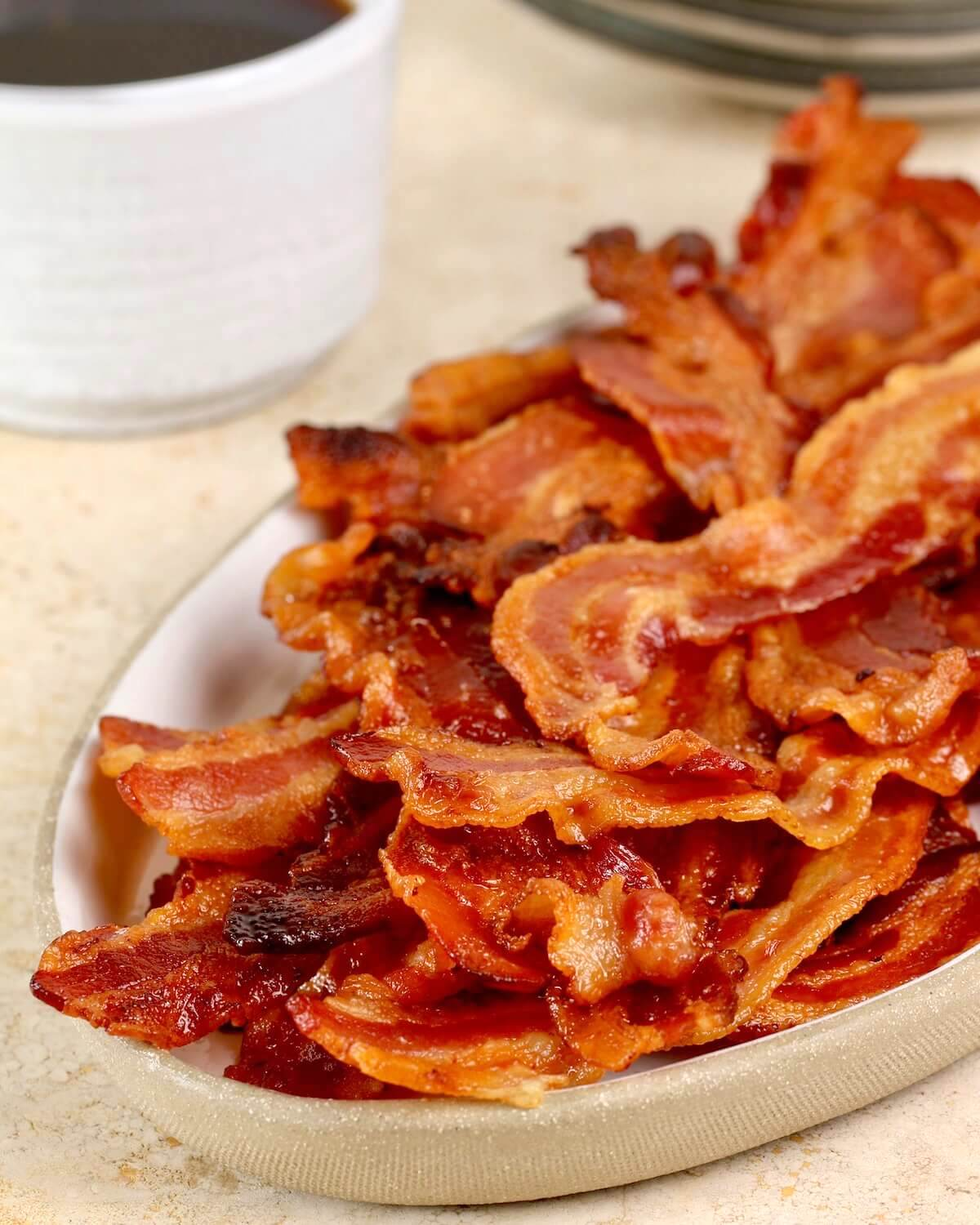 vertical image of bacon with coffee