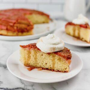 rhubarb cake slice with whipped cream
