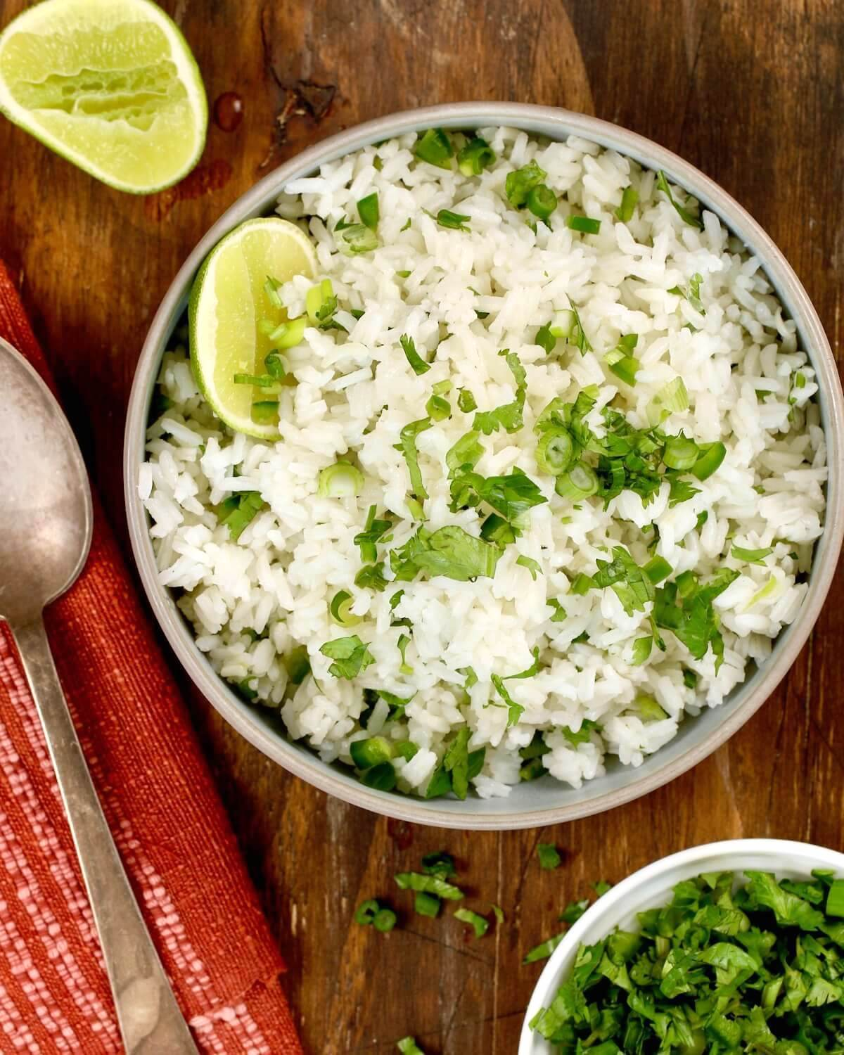 close shot of cilantro lime rice with herbs and scallions