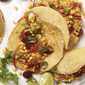 close up of chorizo and corn taco with onions