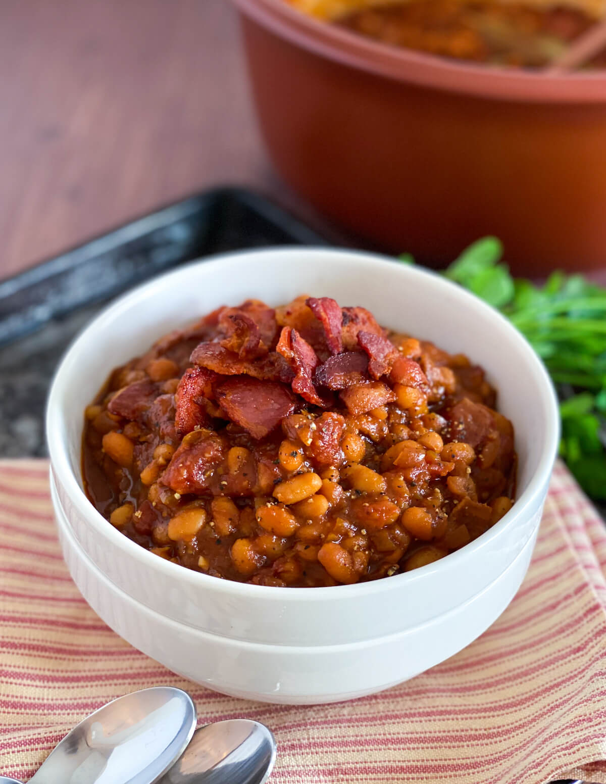 bowl of boston baked beans with bacon on top