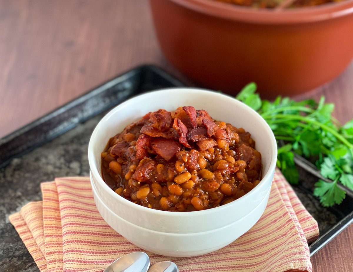 bowl of Boston baked beans with bacon and parsley